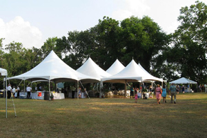 Large tents on the grounds of Locust Grove